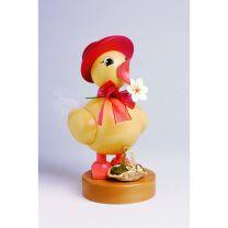 Frühlingsküken mit rotem Hut